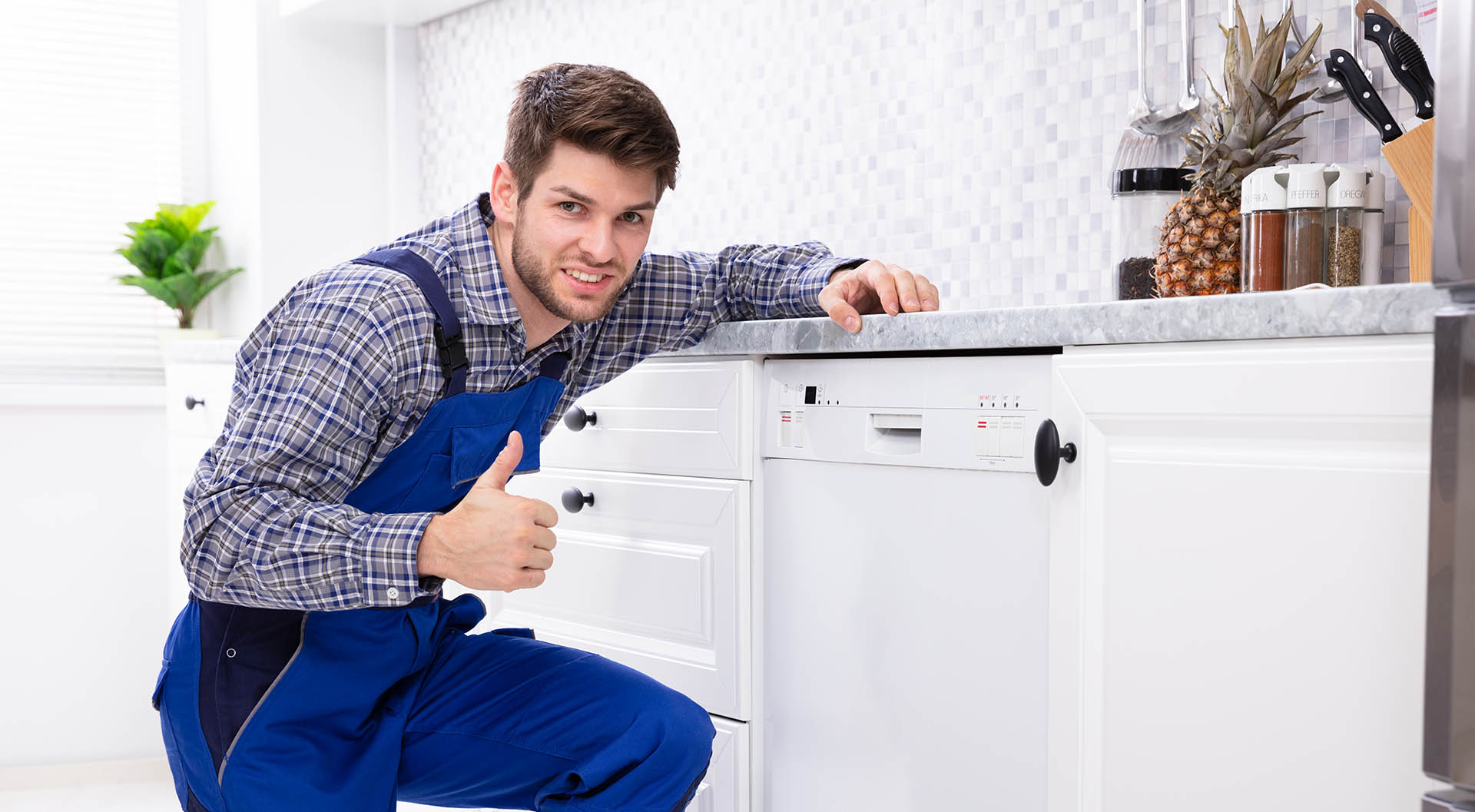Happy Man Gesturing Thumbs Up in kitchen